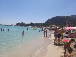 Mondello beach at the shore in summer time, facing East