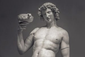 A statue of the Greek god of wine, Dionysus, drinking