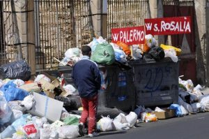 garbage piling up in Palermo. Moan along