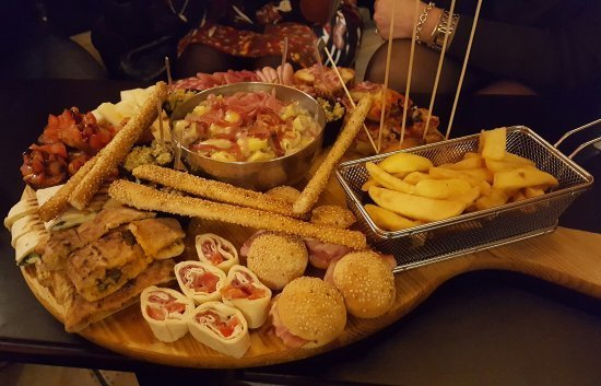 a plate of food that comes with a drink during the aperitif at il Siciliano