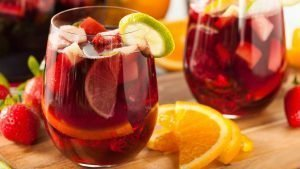 An arsenal of fruit floating in a glass of Spanish sangria